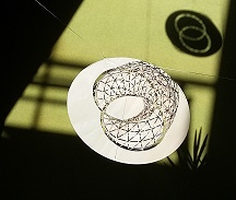 wooden model of villarceau circles with shadow